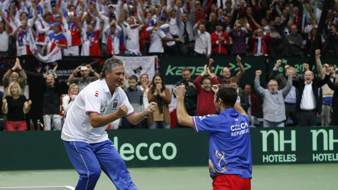Czech Republic's Radek Stepanek, right, celebrates with team's captain Jaroslav Navratil, left, after defeating Spain's Nicolas Almagro in their Davis Cup finals tennis singles match in Prague, Czech Republic, Sunday, Nov. 18, 2012. Czech Republic defeated Spain 3-2 and gained the Davis Cup trophy. (AP Photo/Petr David Josek)