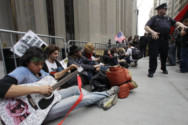 In this Sept. 17, 2011 file photo, demonstrators affiliated with the Occupy Wall Street movement gather to call for the occupation of Wall Street in New York. Monday, Oct. 17, 2012 marks the one-year