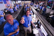The Mars Science Laboratory (MSL) team in the MSL Mission Support Area reacts after learning the the Curiosity rover has landed safely on Mars and images start coming in at the Jet Propulsion Laboratory on Mars, Sunday, Aug. 5, 2012 in Pasadena