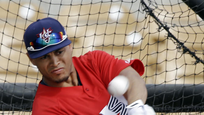 United States' Giancarlo Stanton takes batting practice before an exhibition baseball game Tuesday, March 5, 2013, in Glendale, Ariz. The game is the first of two exhibitions the team will play leading up the the start of the World Baseball Classic. (AP Photo/Mark Duncan)