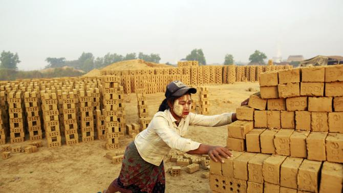 A woman works at a brick kiln on the outskirts of Yangon