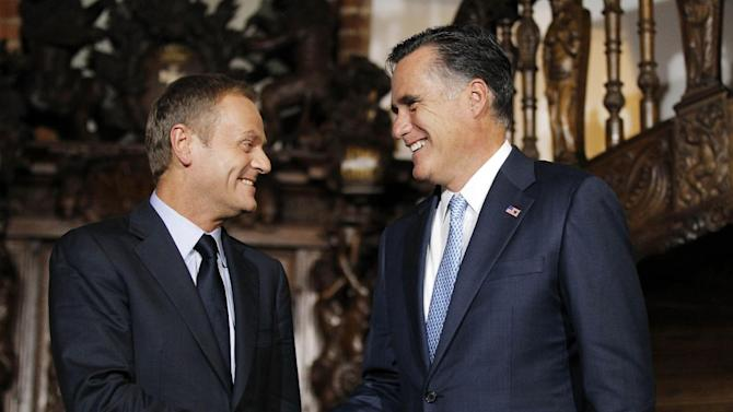 FILE - In this July 30, 2012, file photo Republican presidential candidate, former Massachusetts Gov. Mitt Romney meets with Poland's Prime Minister Donald Tusk at The Gdansk Old Town Hall, in Gdansk. The Bush-ear missile defense program, dear to Poland, was replaced by President Barack Obama early in his presidency.  Romney would reverse Obama's proposed cuts of missile defense spending of about 7 percent, to $9.7 billion in 2013, and wants to maintain Obama's plans in Europe — so long as they work. But he argues that part of Obama's plan is based on theoretical technology and was designed as much to appease Russia as to address threats from Iran.  (AP Photo/Charles Dharapak, File)