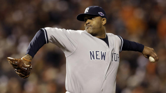 New York Yankees starting pitcher CC Sabathia throws to the Baltimore Orioles in the first inning Game 1 of the American League division baseball series on Sunday, Oct. 7, 2012, in Baltimore. (AP Photo/Patrick Semansky)