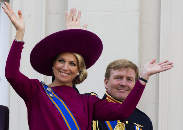 FILE - In his Sept. 18, 1012 file photo Princess Maxima, left, and Crown Prince Willem Alexander, wave to well wishers from the balcony of Royal Palace Noordeinde in The Hague, Netherlands. Prince Willem-Alexanders ascension to the Dutch throne in April 2013 promises to be a shining moment on the world stage for his wife Maxima and her home country of Argentina. But there will be a glaring absence at the ceremony. Queen Beatrixs announcement this week that shell step aside and let her son become king raised new questions about the future queens father, Jorge Zorreguieta, one of the longest-serving civilian ministers in Argentinas 1976-1983 military dictatorship.(AP Photo/Vincent Jannink, file)