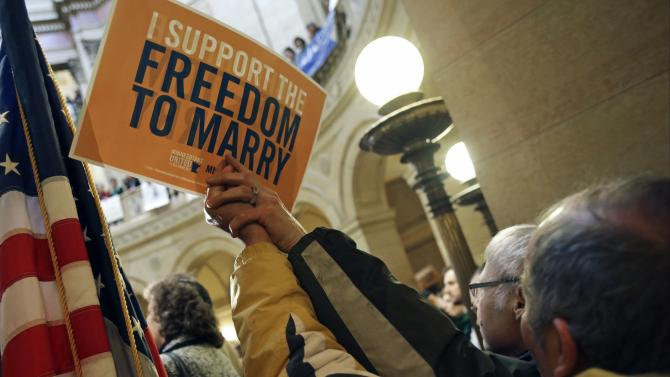 Hundreds gathered at the State Capitol Thursday, Feb. 14, 2013 in St. Paul, Minn., where supporters of gay marriage called for Minnesota lawmakers to legalize gay marriage. (AP Photo/Jim Mone)