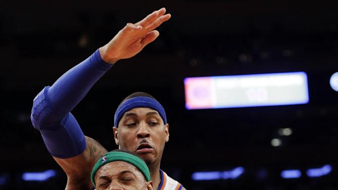 Boston Celtics forward Paul Pierce (34) reacts as New York Knicks forward Carmelo Anthony, rear, defends in the second half of their NBA basketball game at Madison Square Garden in New York, Monday, Jan. 7, 2013. The Celtics won 102-96. (AP Photo/Kathy Willens)