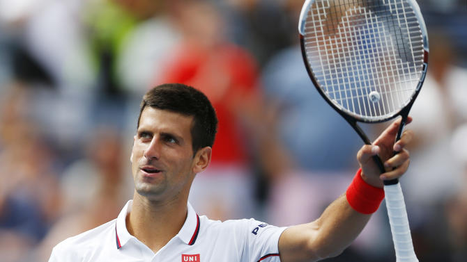 Novak Djokovic, of Serbia, waves to the crowd after defeating Sam Querrey, of the United States, during the third round of the 2014 U.S. Open tennis tournament, Saturday, Aug. 30, 2014, in New York. (AP Photo/Matt Rourke)