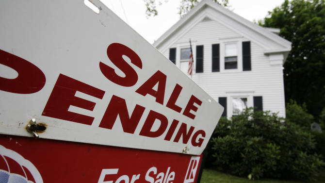 In this July 26, 2011 photo, a sale pending sign is set outside a house in Bath, Maine. The number of people who signed contracts to buy homes rose for a second month in June. But the gain was not enough to signal a rebound in the weak housing market.(AP Photo/Pat Wellenbach)