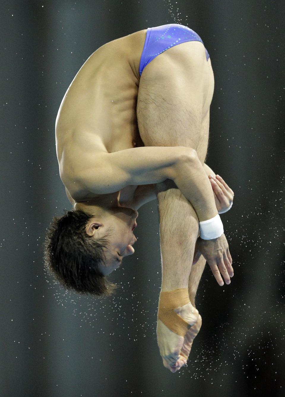Silver medalist Qiu Bo from China competes during the men's 10-meter platform diving final at the Aquatics Centre in the Olympic Park during the 2012 Summer Olympics in London, Saturday, Aug. 11, 2012. (AP Photo/Michael Sohn)