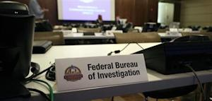 Phone banks dedicated to FBI are shown during tour of MACC at an undisclosed location in the Chicago suburbs
