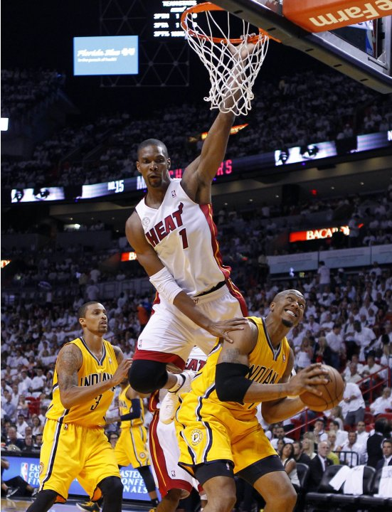 Miami Heat's Chris Bosh fouls Indiana Pacers' David West during Game 1 of their NBA Eastern Conference final basketball playoff in Miami