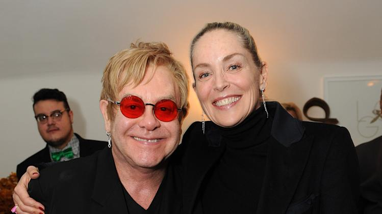"Sharon Stone, right, and Elton John attend LoveGold/EJAF Celebrate ""How to Survive a Plague"" at Chateau Marmont on February 22, 2013 in Los Angeles. (Photo by Jordan Strauss/Invision for LoveGold/AP Images)"