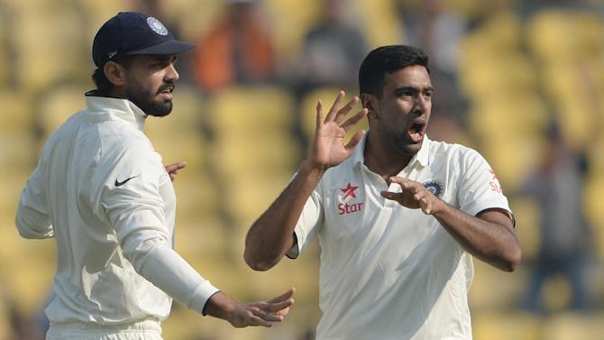 India's Ravichandran Ashwin (right) celebrates after taking the wicket of South Africa's Dean Elgar on the second day of the third Test in Nagpur on November 26, 2015