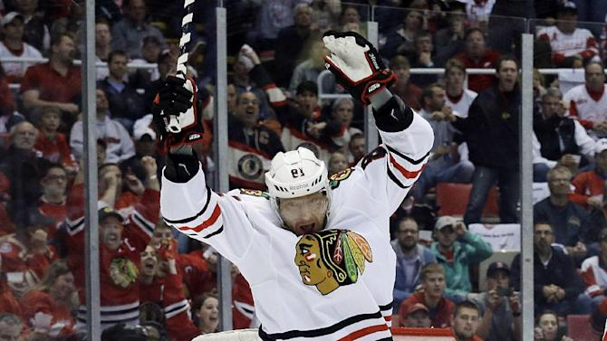 Chicago Blackhawks right wing Marian Hossa (81), of the Czech Republic, celebrates his goal against the Detroit Red Wings during the first period in Game 6 of the Western Conference semifinals in the NHL hockey Stanley Cup playoffs in Detroit, Monday, May 27, 2013. (AP Photo/Paul Sancya)