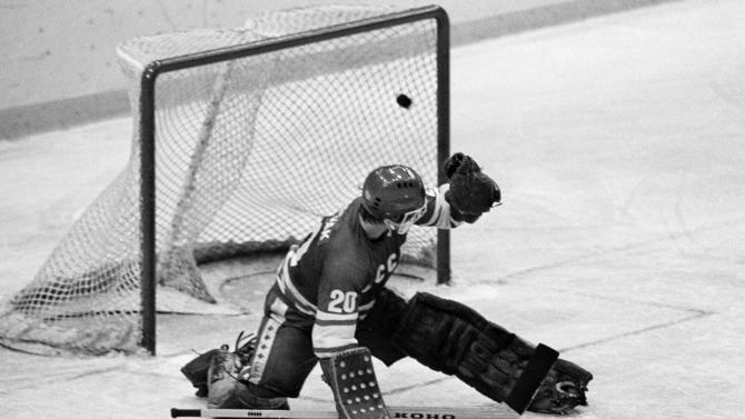 "FILE - In this 1980 file photo, Soviet goalie Vladislav Tretiak allows a goal by the U.S. team in the first period of a medal-round hockey game at the 1980 Winter Olympics in Lake Placid, New York. Tretiak said the U.S. hockey team taught the Soviets a ""good lesson"" about respecting competitors by beating them in the 1980 Olympics. Tretiak, the three-time Olympic gold medalist, gave up two goals in the first period of the ""Miracle on Ice"" at the 1980 Lake Placid Olympics and then was benched in what is widely regarded as the greatest upset in Olympic history. (AP Photo, File)"