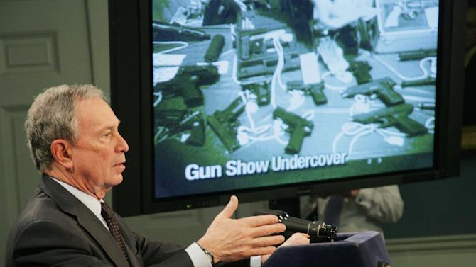 FILE - In this Jan. 31, 2011 file photo provided by the New York NYC Mayor's Office, Mayor Michael Bloomberg shows an undercover video showing a Phoenix, Arizona Gun show at City Hall in New York. Criminologists around the country agree with Bloomberg to some degree when he claims that historic crime lows in New York City are the result of strict, enforced state and local gun laws. (AP Photo/NYC Mayor's Office, Edward Reed, File)