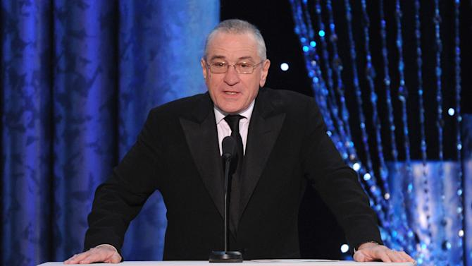 FILE - In a Saturday, Jan. 18, 2014 file photo, Robert De Niro speaks on stage at the 20th annual Screen Actors Guild Awards at the Shrine Auditorium, in Los Angeles. A film company co-founded by De Niro called Tribeca Enterprises is selling a 50 percent stake to the Madison Square Garden Company, according to a deal that was announced Saturday, March 22, 2014. (Photo by Frank Micelotta/Invision/AP)