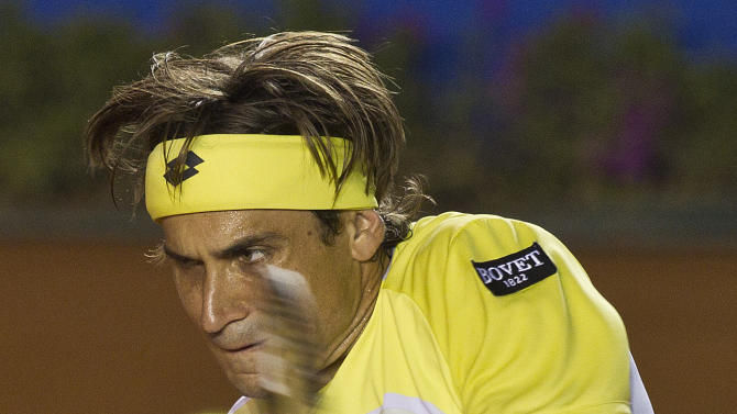 Spain´s David Ferrer returns the ball to Spain´s Rafael Nadal during the final round match at the Mexico Open tennis tournament in Acapulco, Mexico, Saturday, March  2, 2013. (AP Photo/Christian Palma)