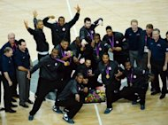 US players pose with their gold medals after winning the London 2012 Olympic Games men&#39;s basketball competition at the North Greenwich Arena in London