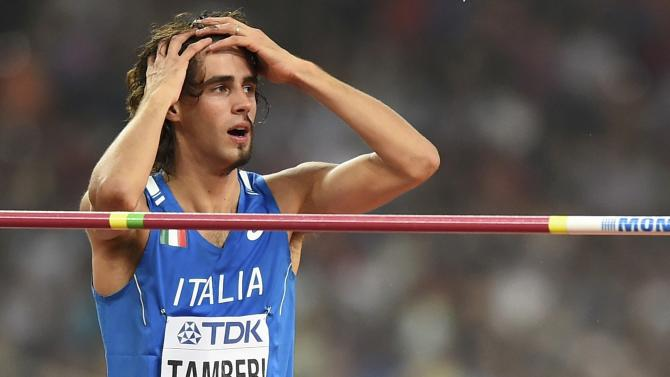 Tamberi of Italy reacts as he competes in the men's high jump final during the 15th IAAF World Championships at the National Stadium in Beijing