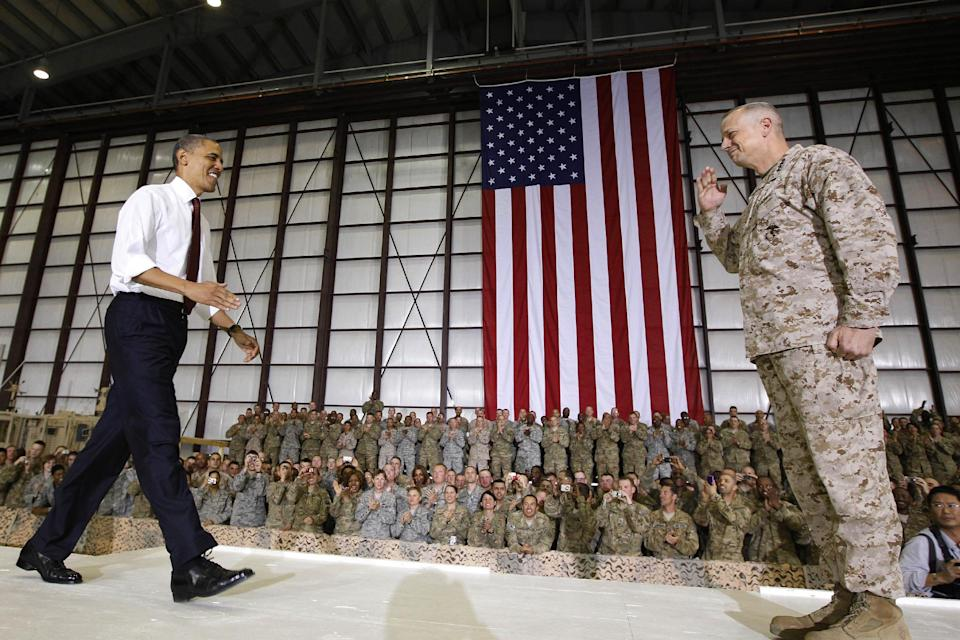 Marine Gen. John R. Allen, commander of the International Security Assistance Force and U.S. Forces Afghanistan, introduces President Barack Obama before he addresses troops at Bagram Air Field, Afghanistan, Wednesday, May 2, 2012. (AP Photo/Charles Dharapak)