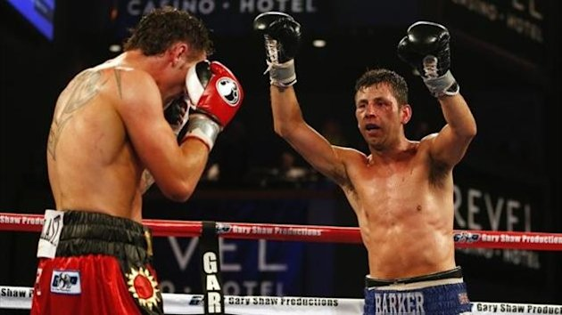 Darren Barker, right, of England celebrates in the closing seconds of the 12th round against Daniel Geale from Australia during their IBF Middleweight Championship fight on August 17, 2013 (Getty Images)