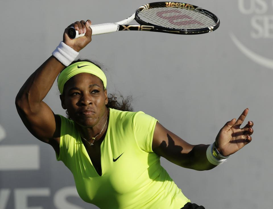 Serena Williams, of the United States, returns to Chanelle Scheepers, of South Africa, during a quarterfinal of the Bank of the West tennis tournament, Friday, July 13, 2012, in Stanford, Calif. (AP Photo/Marcio Jose Sanchez)
