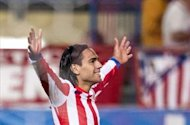 Atletico Madrid 2-1 Malaga: Weligton own goal moves capital club level with Barcelona in La Liga