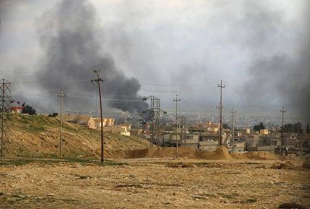 A general view shows the town of Sinjar as smoke rises from what activists said were  U.S.-led air strikes