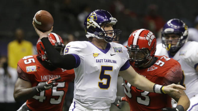 East Carolina quarterback Shane Carden (5) looks for a receiver as he is pursued by Louisiana-Lafayette defensive end Emeka Onyenekwu (45) and defensive lineman Cordian Hagans (93) in the first half of the New Orleans Bowl, an NCAA college football game in New Orleans, Saturday, Dec. 22, 2012. (AP Photo/Bill Haber)