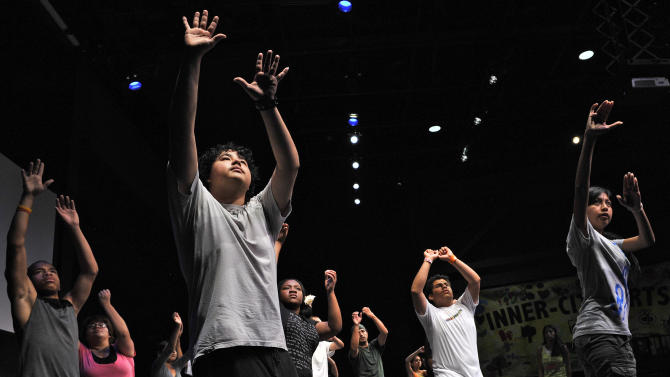 This June 30, 2011 photo shows students rehearsing at the Mark Taper Inner-City Arts academy, in the Skid Row section of Los Angeles. Prince William and his wife, Kate, the Duke and Duchess of Cambridge, will be visiting the academy during their visit to Los Angeles this week. (AP Photo/Mark J. Terrill)
