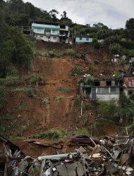 Damaged buildings are seen after a landslide in Nova Friburgo, Rio de Janeiro state, Brazil, Saturday, Jan. 15, 2011. After four nights of torrential rains, mudslides have killed more than 500 people in the Rio de Janeiro area.