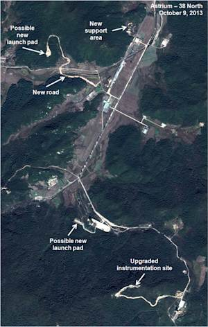 This Oct. 9, 2013 satellite image taken by Astrium, and annotated and distributed by 38 North shows the Sohae site where North Korea launched a long-range rocket into space in December 2012. U.S.-Korea Institute at Johns Hopkins School of Advanced International Studies said Monday, Oct. 28, 2013, North Korea is conducting major construction at its main missile launch site, apparently to accommodate larger rockets and new mobile missiles. (AP Photo/Astrium - 38 North) MANDATORY CREDIT