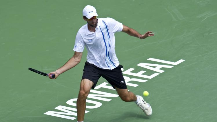 Ivo Karlovic, of Croatia, returns to Tomas Berdych, of the Czech Republic, at the Rogers Cup tennis tournament on Thursday, Aug. 11, 2011, in Montreal. (AP Photo/The Canadian Press, Paul Chiasson)