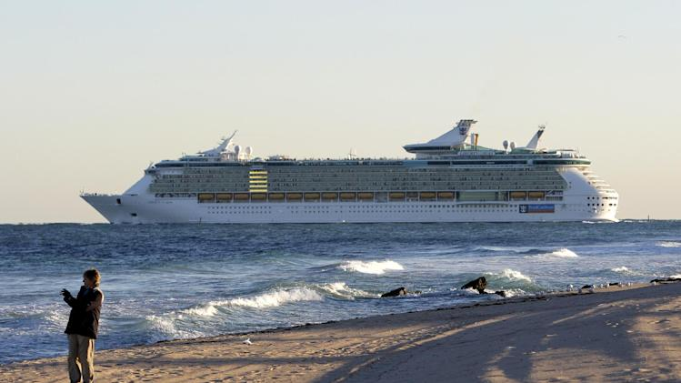 FILE-In this Tuesday, Jan. 3, 2012 file photo, a Royal Caribbean cruise ship Liberty of the Seas heads out to sea, in Fort Lauderdale, Fla. Some tourism officials are suggesting that Broward County change its name to Fort Lauderdale County to capitalize on the international fame of its largest city. (AP Photo/Lynne Sladky, File)