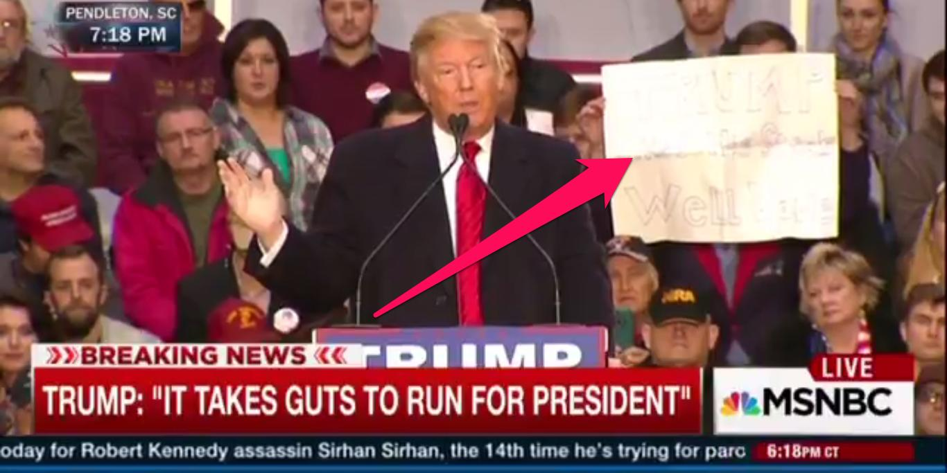 Donald Trump trolled at rally by man standing behind him with bizarre 'steak' sign