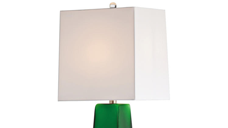 This undated publicity photo provided by Lamps Plus shows a table lamp, Arteriors Home's Roma lamp in emerald green cased glass, a great addition that freshens up a spring room (www.lampsplus.com). (AP Photo/Lamps Plus)
