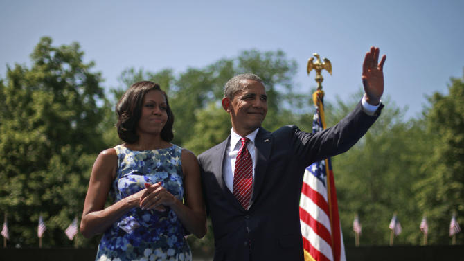 President Barack Obama and first lady Michelle Obama at the Vietnam Memorial on the National Mall in Washington, Monday, May 28, 2012. (AP Photo/Pablo Martinez Monsivais)