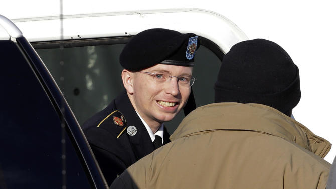 Army Pfc. Bradley Manning, center, steps out of a security vehicle as he is escorted into a courthouse in Fort Meade, Md., Wednesday, Nov. 28, 2012, for a pretrial hearing. Manning is charged with aiding the enemy by causing hundreds of thousands of classified documents to be published on the secret-sharing website WikiLeaks. (AP Photo/Patrick Semansky)