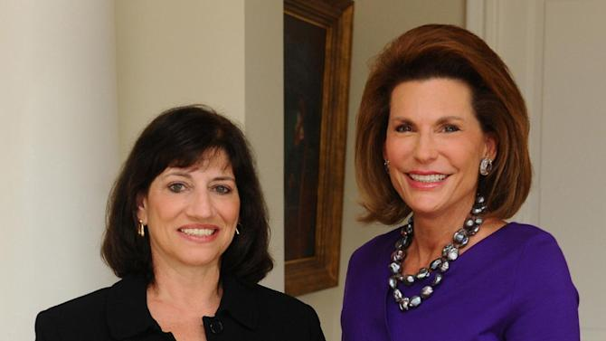 In this undated photo provided by Susan G. Komen for the Cure, new President and CEO Judith A. Salerno, left, is shown with Komen Founder and now Chair of Global Strategy Nancy G. Brinker. The breast cancer charity on Monday, June 17, 2013, announced that it named Salerno as its new leader. Salerno replaces Brinker, the charity's founder, who announced last summer she would step down, following an onslaught of criticism over Komen's decision to stop funding Planned Parenthood. (AP Photo/Susan G. Koman for the Cure)