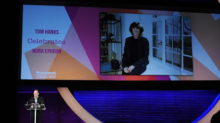 "This image released by Women in the World Conference shows actor Tom Hanks offering a special tribute to the late writer-director Nora Ephron at the Women in the World Conference, Friday, April 5, 2013, in New York. Hanks starred in Ephron's films ""Sleepless in Seattle,"" and ""You've Got Mail,"" and is currently performing on Broadway in Ephron's ""Lucky Guy.""  Ephron died June 26, 2012, of leukemia at the age of 71. (AP Photo/Women in the World Conference, Marc Bryan-Brown)"