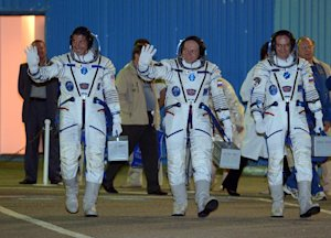 L-R: American astronaut Michael Hopkins and Russian…