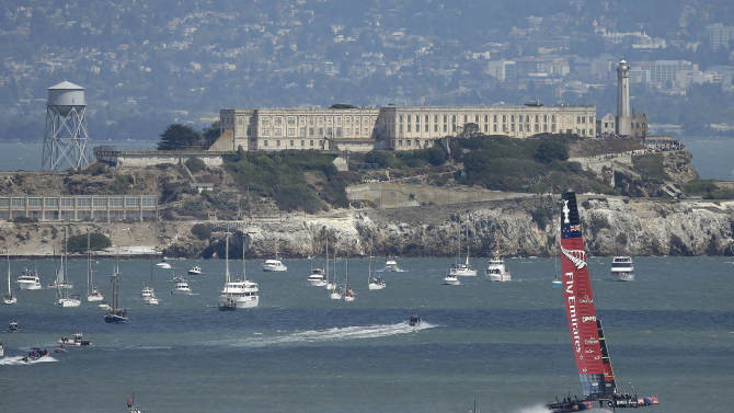 Emirates Team New Zealand sails past Alcatraz Island during the fifth race of the America's Cup against Oracle Team USA in San Francisco, Tuesday, Sept. 10, 2013. Emirates Team New Zealand won the race. (AP Photo/Jeff Chiu)
