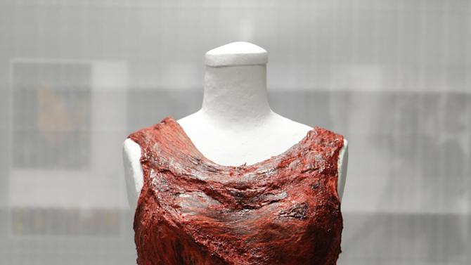 """In this photo taken June 14, 2011,the dress made of meat worn by Lady Gaga at the 2010 MTV Video Music Awards is shown in the vault of the Rock and Roll Hall of Fame and Museum to be shown in the Women Who Rock exhibit in Cleveland, Ohio. The dress has made its way to Washington, along with Loretta Lynn's song about """"The Pill"""" and other relics from music history. Lady Gaga's dress from the 2010 MTV Video Music Awards is being displayed at the National Museum of Women in the Arts with an explanation of her political message. (AP Photo/Mark Duncan, file)"""
