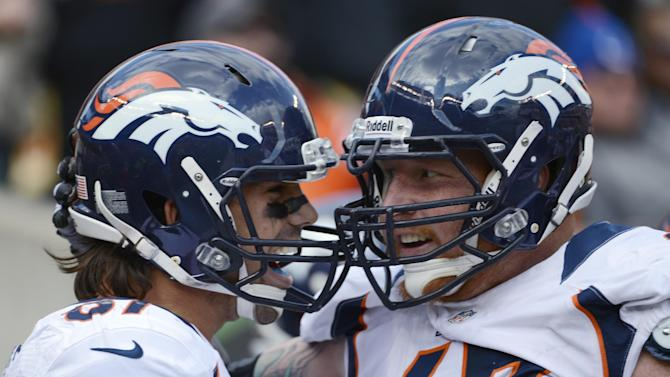 Denver Broncos wide receiver Eric Decker is congratulated by center Dan Koppen (67) after Decker scored on a 13-yard pass reception in the first half of an NFL football game against the Cincinnati Bengals, Sunday, Nov. 4, 2012, in Cincinnati. (AP Photo/Michael Keating)