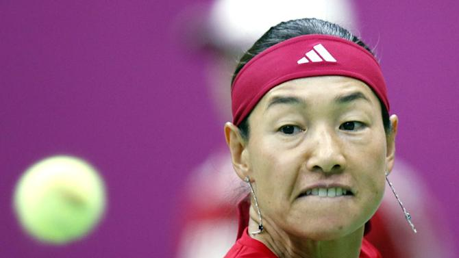 Japan's Kimiko Date-Krumm returns a shot to Russia's Maria Kirilenko during the Fed Cup match between Russia and Japan in Moscow, Russia, Saturday, Feb. 9, 2013. (AP Photo/Misha Japaridze)