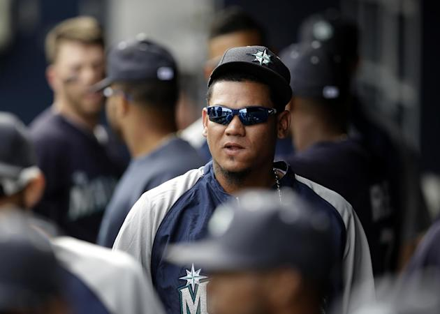 Seattle Mariners' Felix Hernandez walks through the dugout in the fourth inning of an exhibition baseball against the San Diego Padres, Friday, Feb. 28, 2014, in Peoria, Ariz