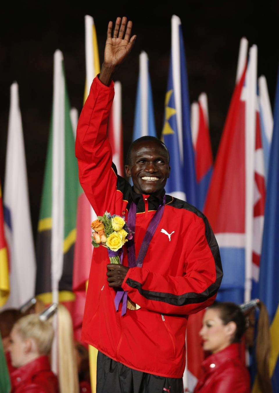 Uganda's Stephen Kiprotich poses with his gold medal for the men's marathon during the Closing Ceremony at the 2012 Summer Olympics, Sunday, Aug. 12, 2012, in London. (AP Photo/Matt Dunham)