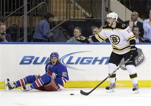 New York Rangers' Carl Hagelin, left, sits on the ice while Boston Bruins' Tyler Seguin reacts after being called for tripping during the third period in Game 4 of the Eastern Conference semifinals in