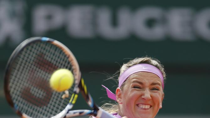 Victoria Azarenka of the Belarus plays a shot to Lucie Hradecka of the Czech Republic during their women's singles match at the French Open tennis tournament at the Roland Garros stadium in Paris